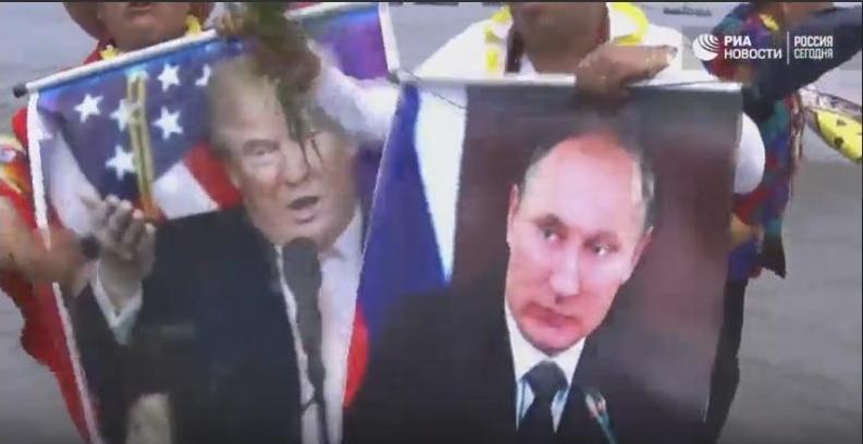 Перуанские шаманы провели обряд над фотографиями Трампа и Путина