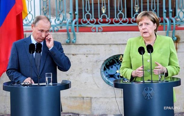 Путин и Меркель обсудили минские соглашения и нормандский процесс