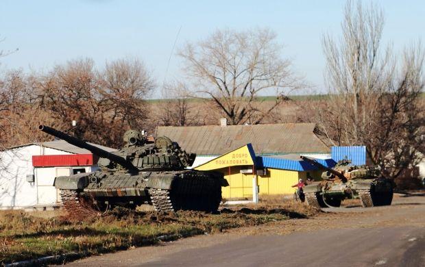 Боевики выдвинули за линии отвода 180 танков и 100 орудий и артсистем