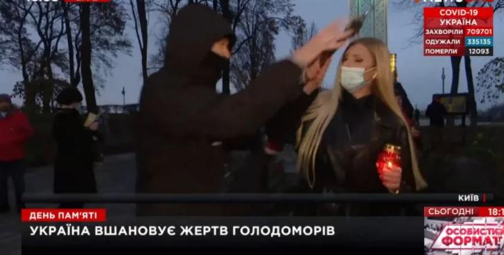 Неизвестный в прямом эфире вырвал у журналистки NEWSONE микрофон и разбил лампадку (ВИДЕО)