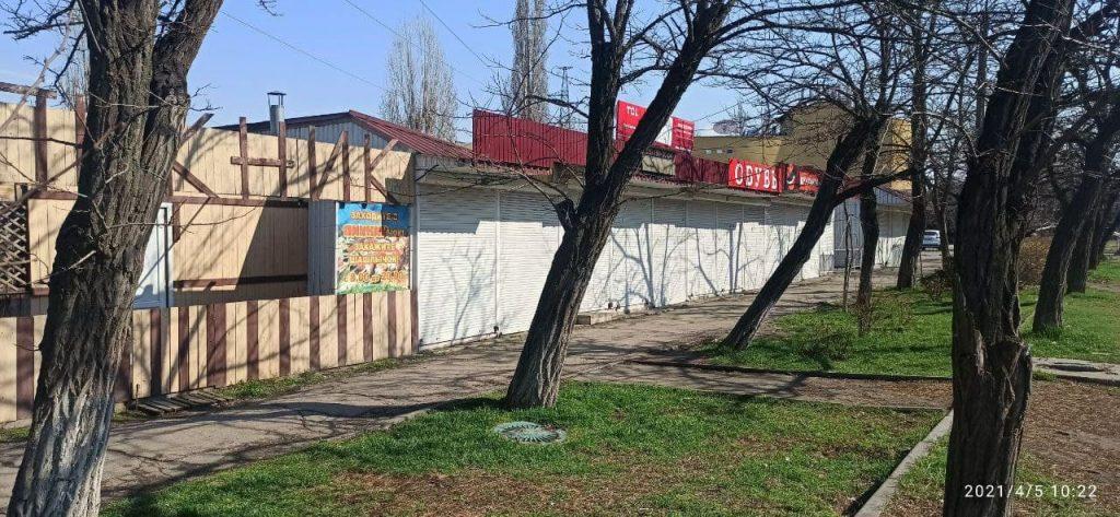 У вещевого рынка на «треугольнике» у автовокзала в Николаеве сносят незаконно установленные киоски (ФОТО) 1