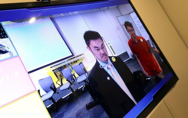 Canon установил в своих офисах в Китае камеры, которые пропускают только улыбающихся сотрудников
